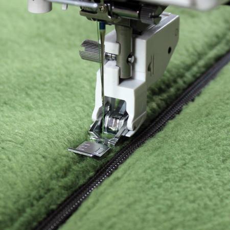 Płoza stopki do wszywania zamków do górnego transportu (do maszyn z szer. ściegu 9 mm), fig. 1