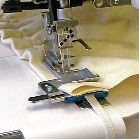 Naprężacz do wszywania gumy do coverloka Janome 1200D, fig. 1