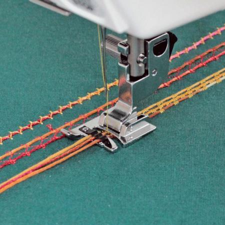 Stopka do naszywania ozdobnych sznurków (do maszyn z szerokością ściegu 9 mm), fig. 1