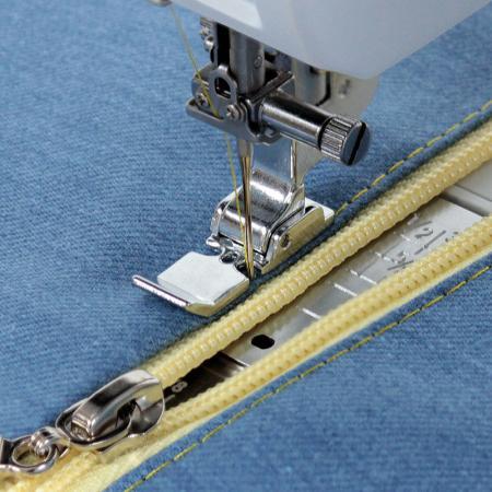 Stopka do wszywania zamków (do maszyn z szerokością ściegu 9 mm), fig. 1