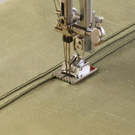 Stopka do wszywania kordu i cienkich wypustek (o średnicy 2,5 mm) (do maszyn z szer. ściegu 9 mm), fig. 1
